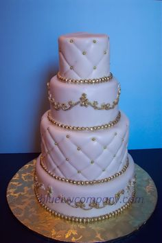 Wedding cake for a client covered with fondant and decorated with piiping, and quilted patterns. Size of cakes: 10-8-6-4.