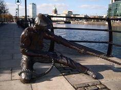 Bronze statue on the Liffey river in Dublin