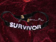 """""""SURVIVOR""""  This is a custom, silver rhinestone letter choker necklace on a 3/8"""" or 5/8"""" velvet ribbon with a claw clasp.  NOTE: You can choose any custom letters!"""