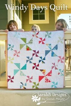 Pin wheel quilt with big and little pin wheels