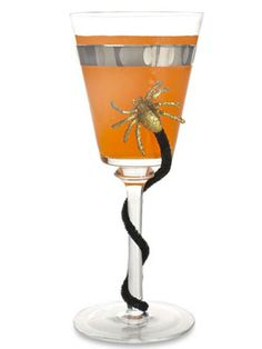 Help guests identify their goblets with shimmery spiders. Spray crafts store arachnids with adhesive, sprinkle each spider with a different shade of glitter, and hot-glue to black pipe cleaners.