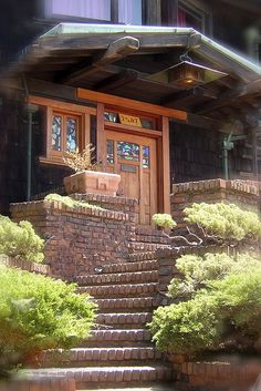 Greene and Greene : The Thorsen House. Is that a heater hanging over head? Either way good idea. Plus cool brick combo with the plants and the door. Good entrance for one of the summer houses.