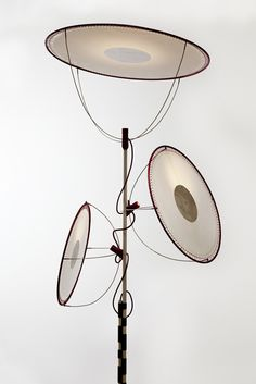 """The Rei floor light, one of an amazing (see the post) series of lights by Wieki Somers at Galerie Kreo. Tjhey are inspired by Japan, including samuari flags the fabric worn by geishas. This one """"...is inspired by a traditional doll that appears to be dancing while holding several hats."""""""