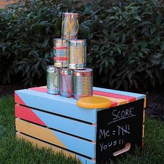 Create this project with Patio Paint Outdoor™ — Transform a wood crate and empty tin cans using Patio Paint and Multi-Surface acrylics into a fun backyard game for everyone.