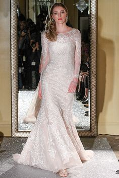 Gown by Oleg Cassini at David's Bridal.Check out more gorgeous dresses in our Oleg Cassini at David's Bridal wedding gown gallery ►