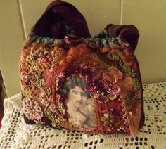 I ❤ crazy quilting & ribbon embroidery . . . This is one of the pieces I will take for show and tell at Quilt festival.  It is supposed to be a lunch bag.  Has pockets inside for drink and cutlery. Right! see me showing up for lunch with that, I would get a few funny looks. So it is going to be a sewing bag. ~By Just Lilla