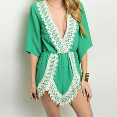 Green Lace Trimmed Romper Brand new green lace short romper in size small...see all styles for more. We have the lastest in jewelry, clothing, swimsuits, watches, sunglasses & more! Rima Imar Tops Blouses