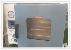 Vacuum leak machine for aluminum bottles.