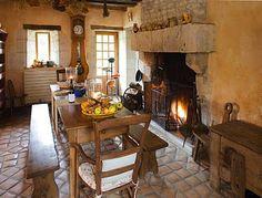 Stone + wood + fireplace in kitchen | Chateau de Rivau