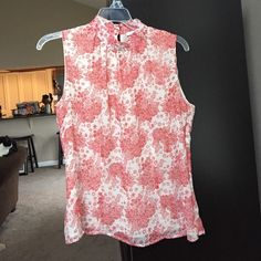 Floral sleeveless blouse Coral and cream floral sleeveless chiffon-type blouse.  High collar, keyhole enclosure at nape of neck with 2 cream buttons.  Side zipper. Apt. 9 Tops Tank Tops