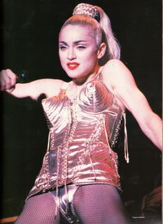 Madonna was a trendsetter for many women and men loved her. Madonna ushered in the vogue for underwear as outerwear on her Blonde Ambition tour in 1990 with a little help from Jean Paul Gaultier and his pointy bras. Kennedy Jr, Jean Paul Gaultier, Divas, Madonna Costume, The Face Magazine, Vogue Magazine, Madonna Pictures, Madonna Images, Madonna Fashion