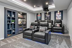 This basement remodel is all about the natural light! It features a custom built home theater, wet bar and dining room, entertainment space, fireplace, home gym, full bathroom. Check out that custom made concession stand? Finished Basement Company, Living Area, Living Spaces, At Home Movie Theater, Custom Built Homes, Entertainment Room, Basement Remodeling, Interior Design, Luxury