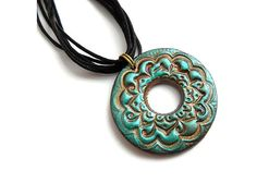 Lotus flower pendant, stamped polymer clay jewelry in teal and light bronze, boho