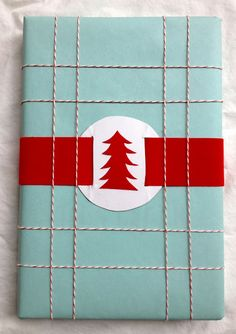 turquoise and red Christmas wrapping -- This would be great for a package that needs to be mailed...nothing gets crushed!
