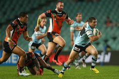 Michael Gordon of the Sharks runs the ball during the round nine NRL match between the Wests Tigers and the Cronulla Sharks at Allianz Stadium on May 10, 2013 in Sydney, Australia.