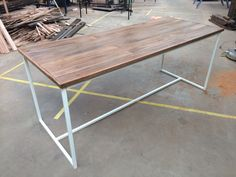 Recycled timber table with an elegant steel fabricated frame powder coated white