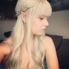 Ilmatke female: light blonde hair, pointed ears, brightly colored eyes