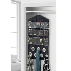 The Studio 3B Multi-functional Jewelery/Scarf/Accessory Organizer features clear see-through pockets for storing jewelry and straps specifically for necklaces. It also includes grommets to handily store your scarves. No assembly required.