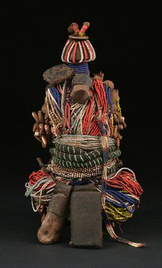 Africa | Fali doll from northern Cameroon | Wood, glass beads, coins, cowrie shells, leather amulets, metal amulets, bones