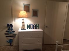 A new mommy proudly displays her son's name in nursery hand cut letter books are the bomb!