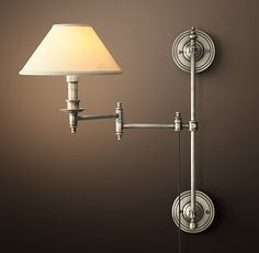 "Julian Swing-Arm Sconce -$325  Special $195 - $275.  While our sconce's candlestick light and finial-topped posts evoke neoclassical French lighting, its swiveling design hearkens to the 1940s. The arm has two pivot points and can be raised and lowered along the stem.  Overall: 4½""W x 16""D x 21½""H - Backplates: 4½"" diam."