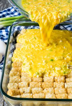 Egg mixture poured over tater tots in a baking dish