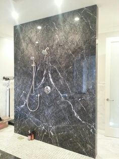Grigio carnico marble slab shower wall.  Seam is bookmatched or butterfly