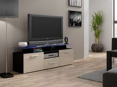 EVORA mini TV Unit is a modern tv entertainment center that will add a unusual look to your living room. It has two doors and one drawer. Glass shelf  at the top - 8 mm thick. The whole body of the stand is manufactured using high quality mdf board in matt black finish (body of the tv cabinet) and fronts cream high gloss finish.
