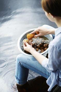 Timo Villanen .... sitting in the water washing potatoes