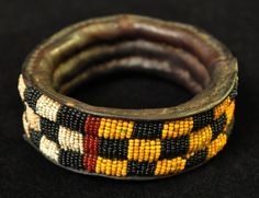 Africa | Bracelet, from the Yoruba people of Nigeria | Leather bracelet with glass beads