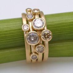 So shiny!  Diamond nesting rings from kyleannemetals on etsy-