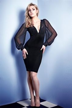 Dangerous sheer black chiffon is styled to perfection in this stunning boudoir inspired cocktail hour dress. Seductive panels lined throughout the body form a firm and sleek hourglass fit. With decadent voluminous sleeves and luxurious French hand beaded embellishment at cuffs, this piece is resplendent in its 1940s Hollywood homage! Delicate gathers a front and deep-V neckline finish this knockout style. Elegant knee length with beautiful volume and sleek lines. A killer eve ...