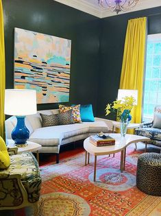 Mid-century furniture with an eclectic mix of brights, leopard prints. and vintage rugs--Asmara Inc.
