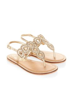 Our metallic bead-embellished sandals for girls are decorated with cut-out hearts. Adjustable straps create a secure fit, while flat, gripped soles provide c...