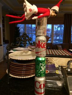 Ginger, Elf on the Shelf flying using the recycables. 2014