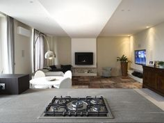 Casa Même, Torino by IDEeA Interior Design e Architettura with Flos Arco
