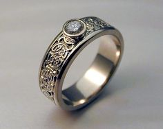 8th to 9th century Celtic wedding band with diamond.