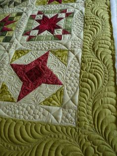 Sewing & Quilt Gallery: Holiday Stars by Margaret.  More than a mile's worth of thread went into the pebbling (and other quilting)