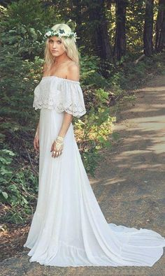 This Bohemian wedding dress will have you floating down the aisle. The chiffon and satin material makes the dress light and creates beautiful movement. The Bateau neckline with the scalloped lace edge