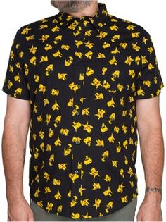 The Pokemon Pikachu Jumble Woven Shirt is black with a double-sided print, a front button closure and a patch pocket at left chest. The shirt is covered by small images of Pikachu, the cute yellow mascot for the Pokemon universe.