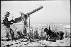 U.S. Army Ranger manning anti-aircraft gun, Sicily, 1943. Read more: Phil Stern: Classic World War II Photos, Italy, 1943 | LIFE.com