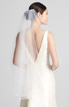 Free shipping and returns on WEDDING BELLES NEW YORK 'Mable' Veil at Nordstrom.com. Elegant satin trim traces the gracefully curved cut of an ethereal, face-framing veil.