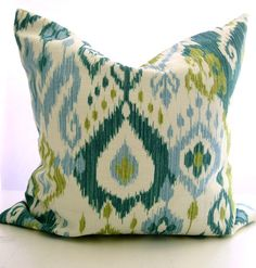 Ikat decorative pillow/ Green teal ivory/ 18 inch. $30.00, via Etsy.