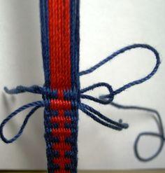 Finishing off a woven band: when you are 3 turns from the end, cut 2 lengths of string, 6inches long. lay one in the shed of the 1st turn as a loop, 1 in the shed of the 2nd turn as a loop, but pointing the other way. The 3rd turn, pass the shuttle tail one last time and cut it. Feed the tail back through the 3nd loop, and pull the ends through. Then feed the tail through the 1st turn loop and pull its ends through. This locks in the end of the weaving so the band does not unravel.