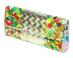 This clutch purse is made using candy and snack wrappers. Folded into strips and woven tightly. The silver wrappers at the center of the purse are using the reverse side of the wrappers.  It has a detachable strap. Polyester fabric used for lining. Using YKK zipper for the internal pocket Its flap closure uses Velcro for latching.   Dimensions in inches: 12 long, 5.5 tall, 2.2 thick at the base Dimensions in centimeters: 30 cm long, 14 cm tall, 5.5 cm thick at the base…