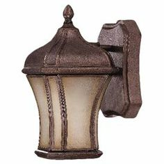 "Joss and Main  $71.95  Outdoor wall lantern with a walnut patina finish and Tuscan glass panels.  Takes (1) 100W bulb  11.25""H x 6""W"