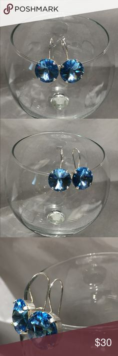 Swarovski Aquamarine crystal SS leverback earrings ▪️Swarovski Aquamarine 18mm rivoli crystals in a .925 sterling silver plated earring base. ▪️These earrings are gorgeous!  ▪️The sparkle on these is fabulous ▪️They are brand new! Never worn ▪️Due to the nature of the sterling silver these earrings will need to be cleaned/polished frequently.  ▪️There are some superficial scratches on the back of the earrings. Please see last photo.  ❌🙅🏽Trades 👍🏽Reasonable offers only! Jewelry Earrings
