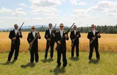 groomsmen and groom with guns