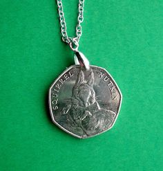 Novelty necklace, Beatrix Potter's Squirrel Nutkin commemorative coin from 2016 on a Sterling Silver chain by VintageIrishDresser on Etsy Commemorative Coins, World Coins, Beatrix Potter, Sterling Silver Chains, Squirrel, Pendant Necklace, Unique Jewelry, Handmade Gifts, Etsy