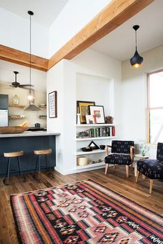 Inside an Eclectic Austin Kitchen via @MyDomaine | wood floors, white walls, and wood accents and trim